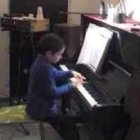 Ariel Lanyi, 9 year old boy, jazz- improvising on the piano